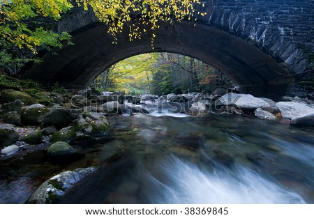 Old stone bridge over river in the Great Smoky Mountains - stock photo