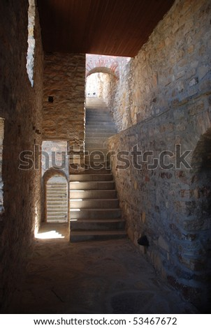 old stone castle gate with staircase and door to dungeons in an ancient style - light and darkness