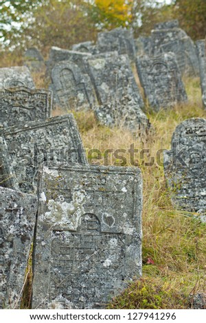 old stone gravestones in a Jewish cemetery - stock photo