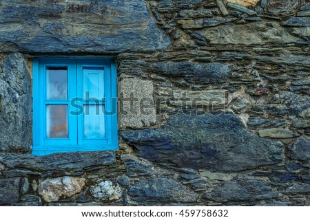 Old Stone House with Blue Window