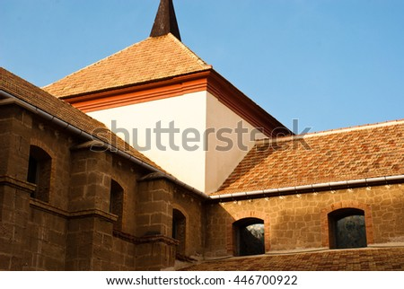 Old stone house with tiled roof with blue sky. Spain, Europe. - stock photo