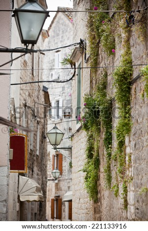 Old Stone Narrow Streets of Trogir, Croatia. Vertical shot - stock photo