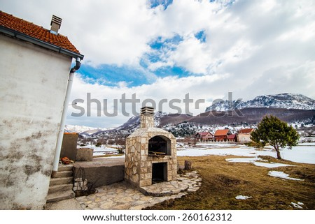 Old stone oven near the house - stock photo