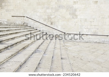 Old stone staircase railing, detail of a old stairs in a monument - stock photo