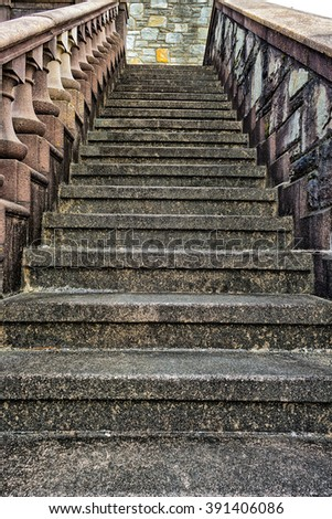Old, stone stairs on side of building - stock photo