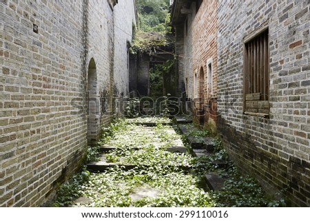 Old stone stairs to the old house overgrown with moss  - stock photo