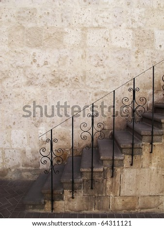 Old stone stairs with metal railings, Peru. - stock photo