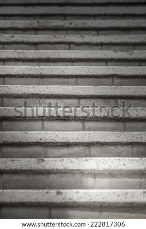 Old stone steps leading up a dark alleyway  - stock photo