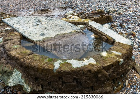 Old stone structure seen  on  Thames beach during a low tide, London, UK - stock photo