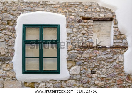Old Stone Wal with Closed Window - stock photo