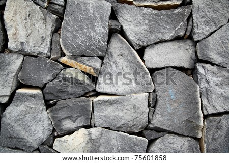Old stone wall, may be used as background - stock photo