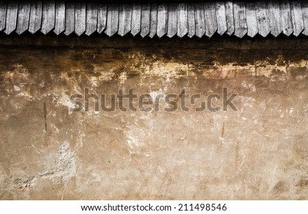 Old stone wall with wooden roof tile