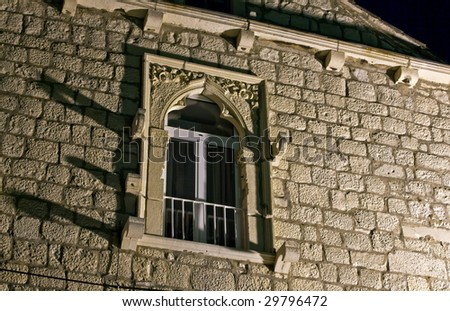 Old stone window in old medieval town Korcula  by night. Croatia, Europe. - stock photo