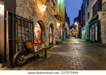 Old street in Galway, Kerwan's Lane, decorated with christmas lights, night scene - stock photo