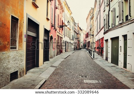 Old street in Italian town of Parma, Italy. Color toning effect applied. - stock photo