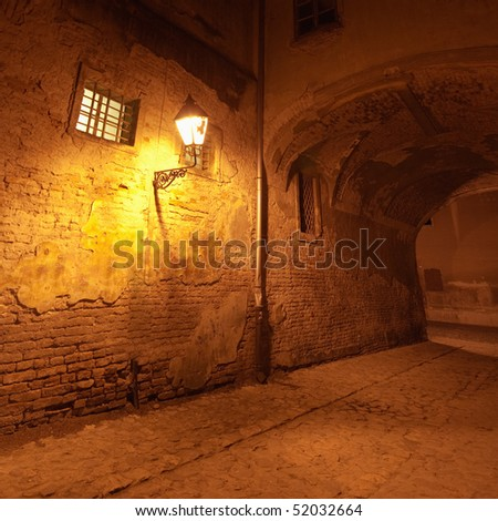 Old street with lamp - stock photo