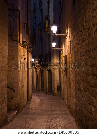 Old streets of medieval Girona by night, Catalonia,  Northern Spain