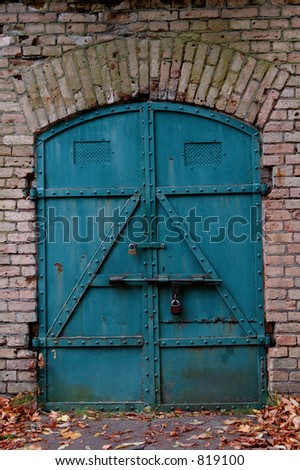 Old strong door to the warehouse, metal,
