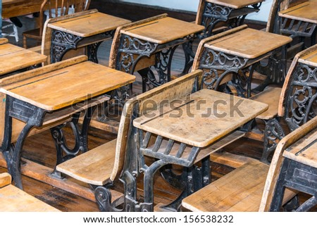 Old Student Classroom Desks - stock photo