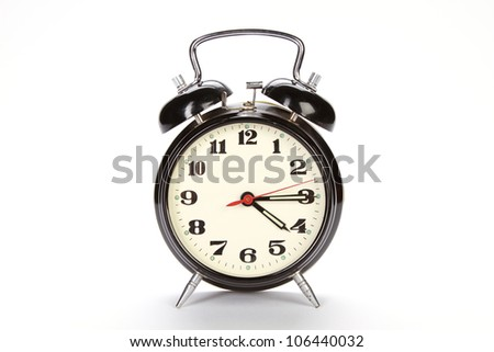 old style alarm clock isolated on white