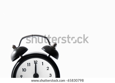 old style alarm clock on white background