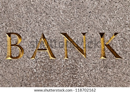 """Old style bank building with a """"BANK"""" text on it - stock photo"""