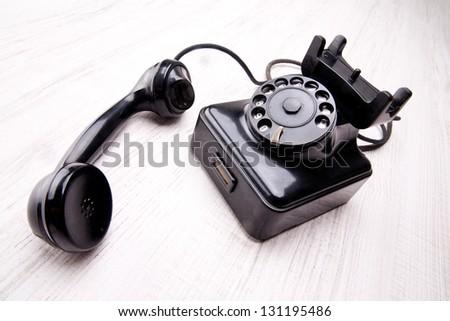old style black telephone - stock photo