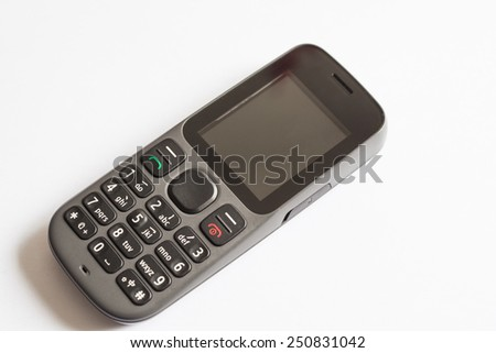 Old style cellphone with chinese symbols on keyboard - stock photo