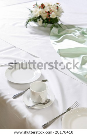 Old style dinning room table set for a breakfast. - stock photo