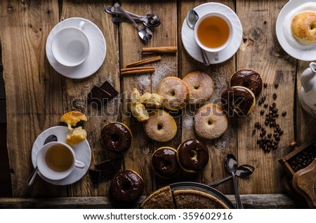 Old style donuts with sugar and dark chocolate, whole table, place for your advertising