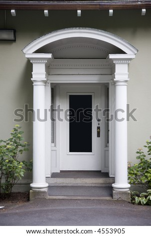 Old style doorway with aches and columns - stock photo