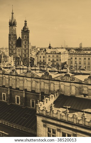 Old style photo of The tower of Mariacki Church in Cracow, Poland. - stock photo