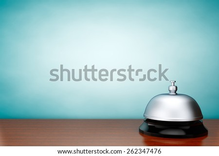 Old Style Photo. Rare Service Bell on the table - stock photo