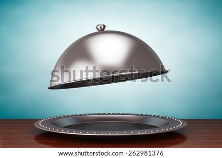 Old Style Photo. Silver Restaurant cloche on the table - stock photo