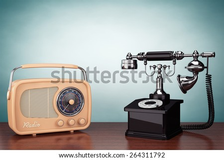 Old Style Photo. Vintage Telephone and Radio on the table - stock photo