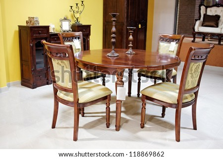 old style table chairs furniture - stock photo