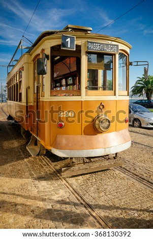 Old style trolley in downtown Porto. - stock photo