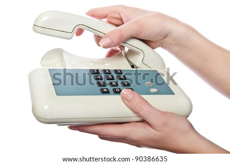 Old-style wired phone in woman's hands. Isolated on white