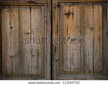 Old style wooden door closed. - stock photo