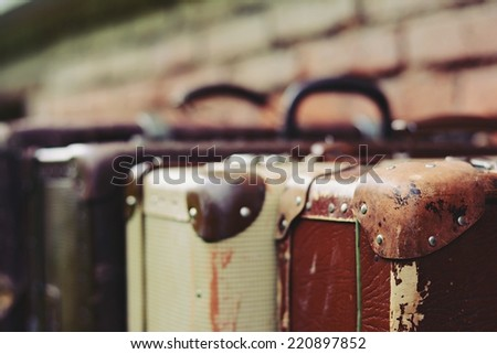Old stylish brown suitcases with retro effect - stock photo