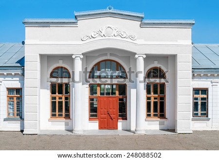 Old suburban office building with an empty signboard - stock photo