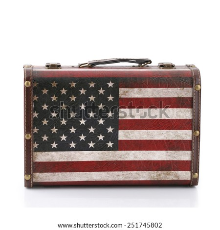 Old suitcase made of leather and wood. Stripes of the American flag isolated on white background. This has clipping path. - stock photo