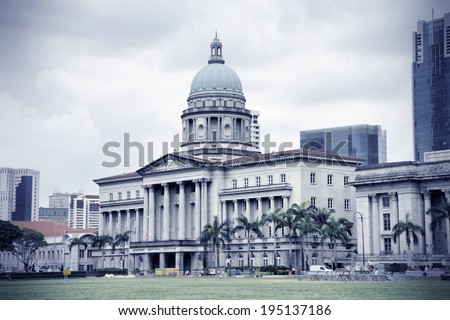 Old supreme court building in Singapore. Classical architecture in colonial style. Cross processed color tone - retro filtered style. - stock photo