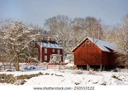 Old swedish farm buildings in the small village Aboda (Kalmar county) in wintry landscape. - stock photo