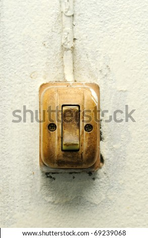 Old switch on white wall - stock photo