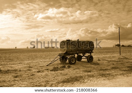 old tanker trailer in countryside - stock photo