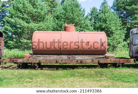 old tanks with oil and fuel transport by rail - stock photo