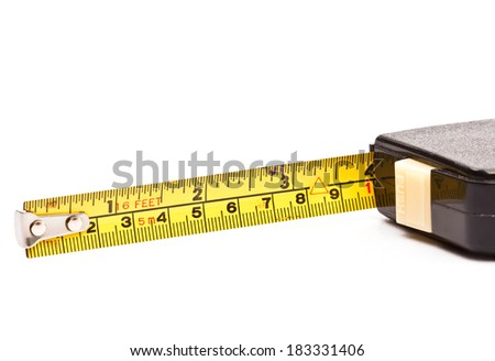 Old tape measure on white background.