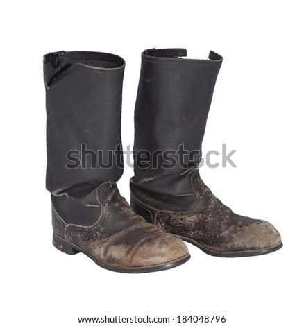 Old tarpaulin military boots isolated on a white background