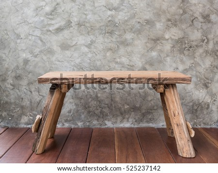 Old teak wood chair on wooden floor with cement art background